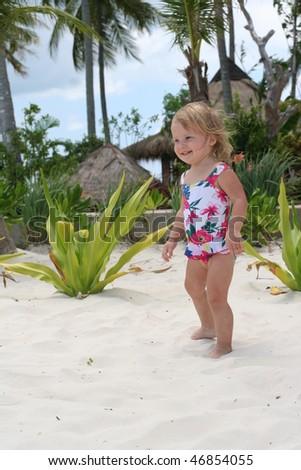 Little cute girl on beach - stock photo