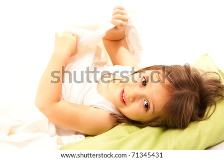 little cute girl on her bed - stock photo