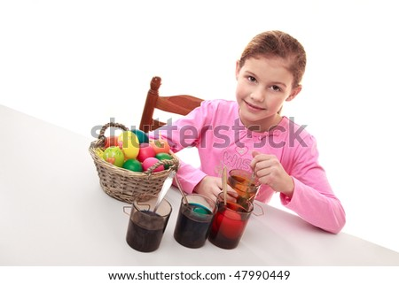 Little cute girl painting easter eggs