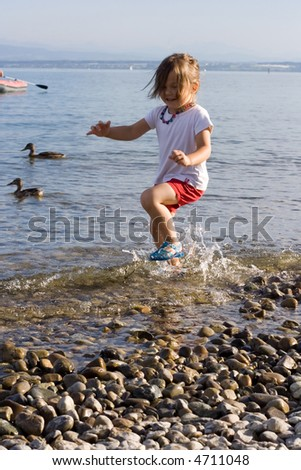 little cute girl playing at the beach.