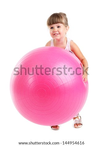Little cute girl playing with big ball, isolated on white