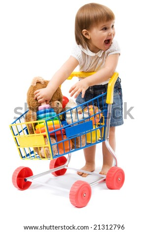 Little cute girl playing with toy shopping cart - stock photo