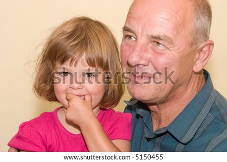 little, cute girl spending time with her grandfather
