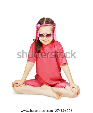 Little cute girl wearing pink clothes is sitting like a yogi - stock photo