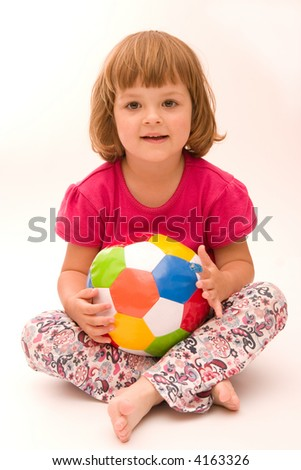 little, cute girl with colorful football isolated on white