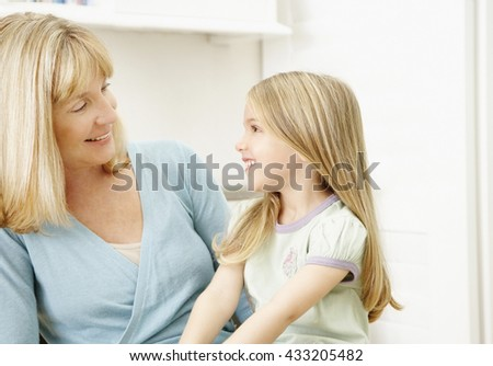 Little cute girl with her mother - stock photo
