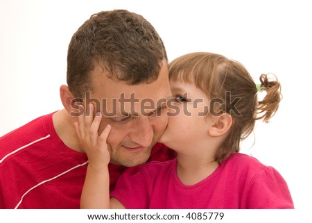 little, cute girl with pigtails giving a kiss to her father