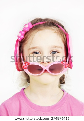 Little cute girl with pink sunglasses having fun - stock photo