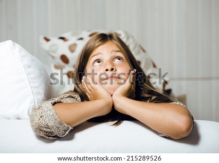 little cute real girl at home interior smiling - stock photo
