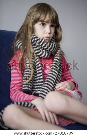 Little cute sick girl with scarf. Sore throat - stock photo