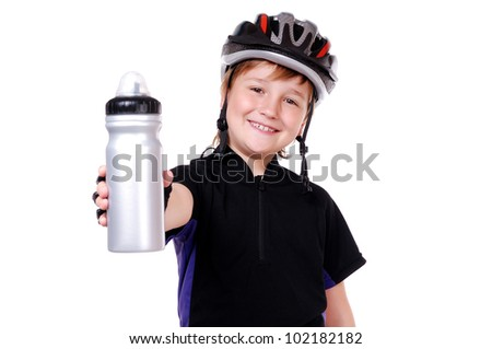 Little cyclist holding a water bottle - stock photo