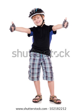Little cyclist showing thumbs up  full length portrait in a white studio - stock photo