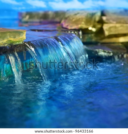 Little decorative waterfall - stock photo