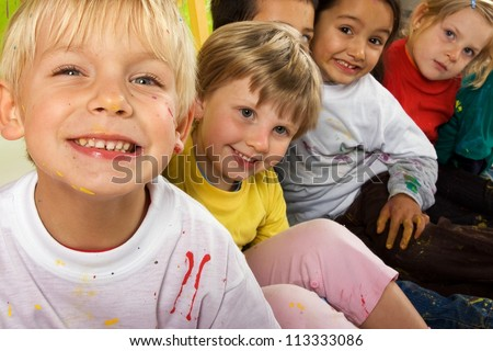 Little dirty smiling painters - stock photo