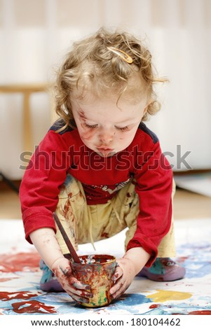 Little dirty toddler drawing - stock photo