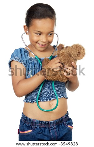 Little doctor examining her bear a over white background - stock photo