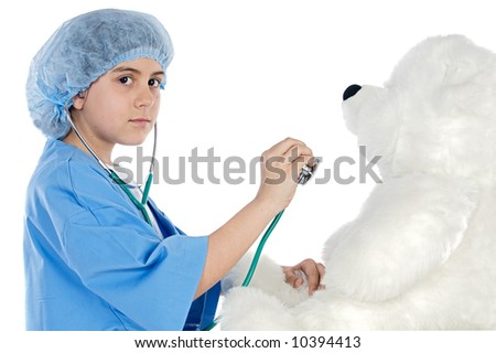 Little doctor examining her teddy  bear a over white background - stock photo