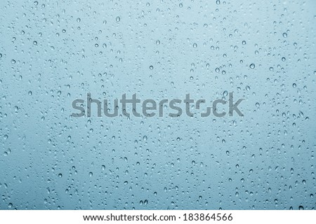 Little drops of water, in the blue glass