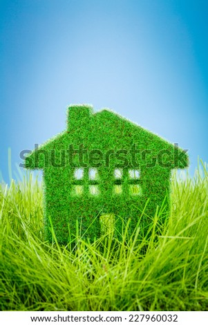 Little Eco House on the green grass - stock photo