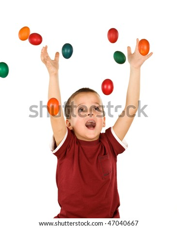 Little ecstatic boy with falling easter eggs - isolated - stock photo