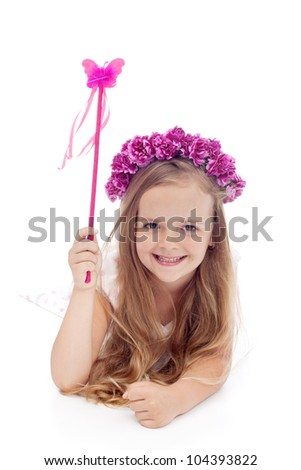 Little fairy with flower wreath and magic wand smiling - stock photo