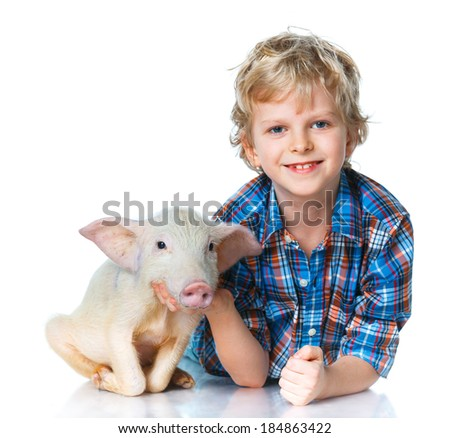 Little farmer. Cute boy with pig. Isolated on white background. - stock photo