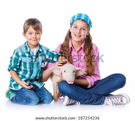 Little farmers. Cute gir and boyl with pig. Isolated on white background. - stock photo