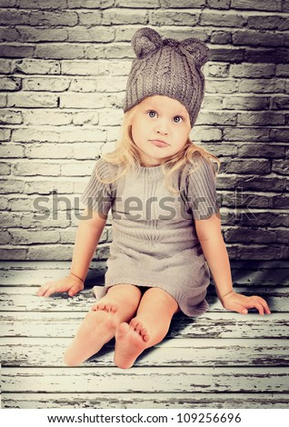 Little fashionable girl in warm clothes - stock photo