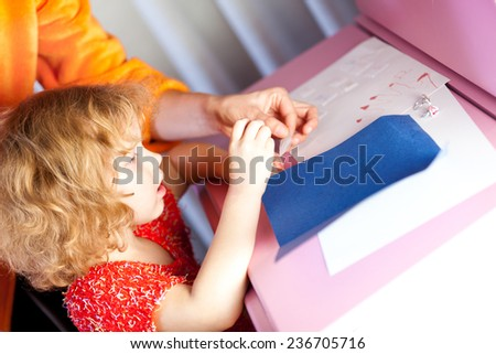 Little four year old girl happy to be in school - stock photo