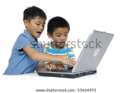 Little friend working on the laptop - stock photo