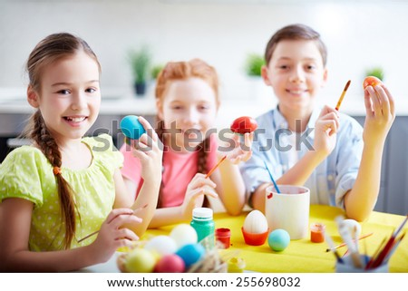 Little friends with Easter eggs - stock photo