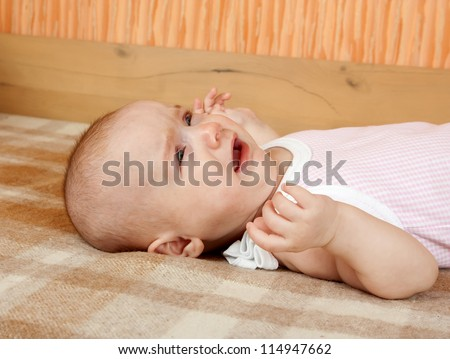 Little frustrated baby crying. Portrait of a close-up - stock photo