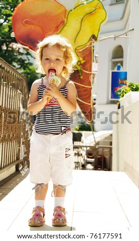little funny blonde girl eating big ice cream - stock photo