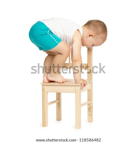 little funny boy on a chair - stock photo