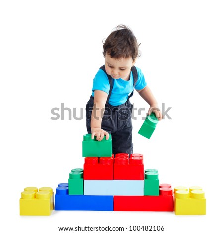 little funny boy plays with colorful cubes