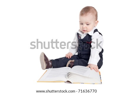 little funny boy reading book isolated on white