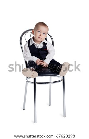 little funny boy sitting on a chair