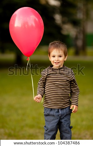 little funny boy with balloon - stock photo