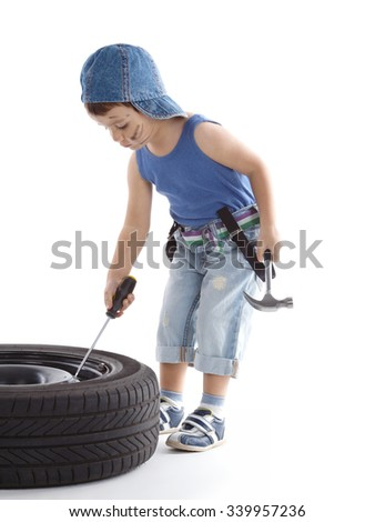 little funny boy with car wheel on white background - stock photo