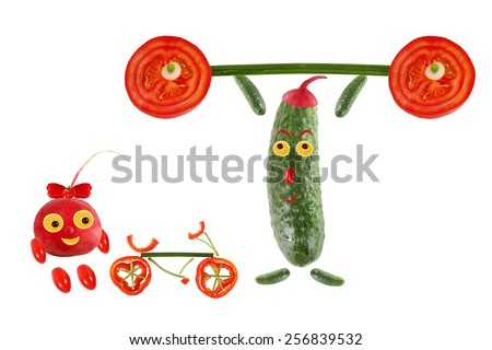 Little funny cucumber raises the bar next to it stands a radish with a bicycle - stock photo