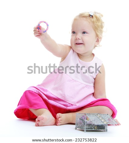 Little funny girl holding a decoration.Isolated on white background .