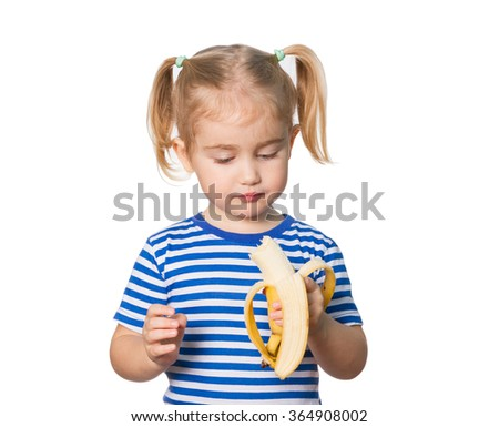 Little Funny girl in striped shirt eats banana. Isolated on white background - stock photo