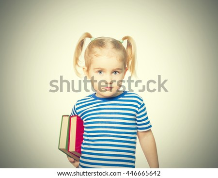 Little Funny girl in striped shirt with books. Isolated on white background - stock photo