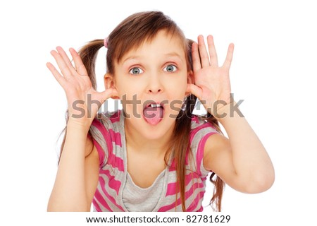little funny girl making faces over white background - stock photo