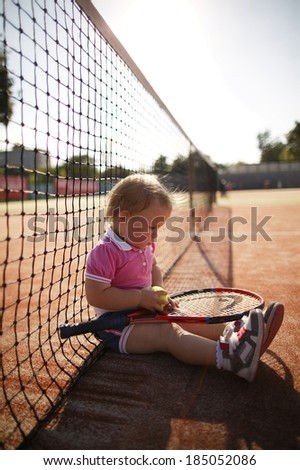 little funny girl plays tennis