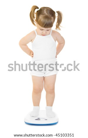 Little funny girl stand on scales isolated - stock photo