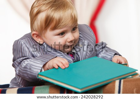 Little genius with book for reading - stock photo