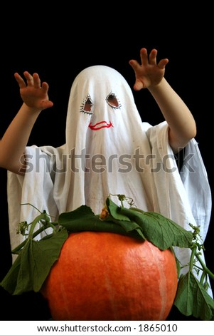 Little ghost and pumpkin - stock photo