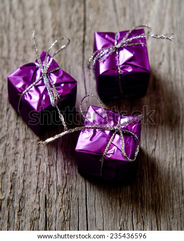 Little gifts boxes fasten with ropes on the wood backing closeup - stock photo