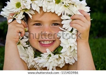 Little girl and a white flower wreath